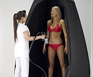 Enhance Spray Tanning use a spray tan cubicle to protect carpet and furnishings